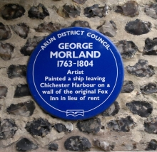 A plaque commemorating the fact that the painter George Morland painted a picture of a ship on the wall of the Fox Inn in lieu of rent.